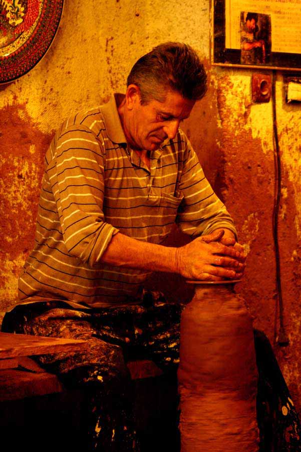 A man demonstrating on how to make a pot